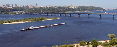 Kiev and the river Dnepr with the barg. Panorama of Kiev and the river Dnepr with the barge stock image