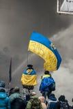KIEV, UCRÂNIA - 25 de janeiro de 2014: Protestos antigovernamentais maciços Fotografia de Stock