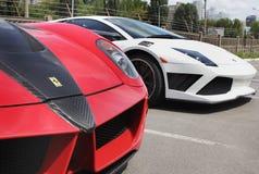 Kiev Ukraina; April 11, 2016 Ferrari 599 GTB Fiorano Stallone Mansory & Lamborghini Murcielago IMSA arkivfoto