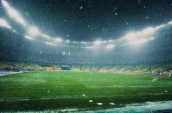 KIEV UKRAINA - December 12, 2018: Olympic Stadium under ett snöfall under UEFA Champions Leaguematchen mellan Shakhtar royaltyfri fotografi