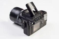Kiev Ukraina - Februari 04 2017: FotoPanasonic Lumix DMC-FZ10 mirrorless kamera med digital skärm bakom Royaltyfria Bilder