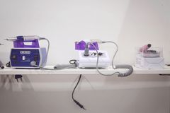 KIEV, UKRAINE – 19 SEPTEMBER, 2018: Electric Nail Drill Machine for Professional hardware manicure on the shelf in the store. Nail Drill Set for Acrylic royalty free stock photos