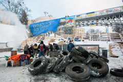 KIEV, UKRAINE: Active people build the barricades with car tires on the main square of capital Stock Photos