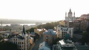 Kiev Ukraine aeriel drone view to Andriyivskyy Descent, Podil, St.Andrew`s Church, river Dnepr. Beautiful sunrise. Kiev Kiyv Ukraine aeriel drone view to stock footage