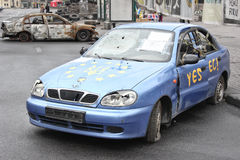 KIEV, UKRAINE - APR 20, 2014: Downtown of Kiev. Broken machine with the EU flag and the coat of arms of Ukraine. Riot in Kiev and. Western Ukraine.April 20 Royalty Free Stock Photography