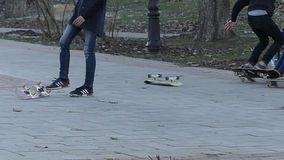 Kiev, Ukraine - APR 8, 2018: young man performing a trick with his skateboard in skate park. Sport, active life concept.  stock video footage