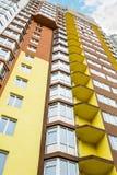 Kiev, Ukraine - April 08, 2016: Big colorful apartment building. Big colorful apartment building against blue sky in residential settlement. Modern concrete Stock Photos