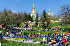 KIEV, UKRAINE - April 17, 2017: Easter folk festival. In the foreground people participating in the Easter folk festival, in the background Kovnirsaya bell tower Royalty Free Stock Photo