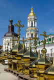 KIEV, UKRAINE - April 17, 2017: The Lavra Crosses, April 17, 2017, Kiev, Ukraine. In the foreground there are rows of differently sized domes of dome crosses, in Royalty Free Stock Images