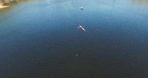KIEV, UKRAINE - April 16, 2017: Rest and recreation in the pond a kayak rowing. Aerial river and canoeing sport stock video