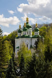 Kiev, Ukraine - April 15, 2017 - St. George`s Cathedral in Vydub. View of the St. George`s Cathedral of the ancient Vydubitsky monastery, in the background tree Royalty Free Stock Photos