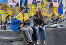Kiev, Ukraine -  August 24, 2016: Boy and girl sing patriotic so. Kiev, Ukraine - August 24, 2016: Boy and girl sing patriotic songs at the Independence Square Stock Images