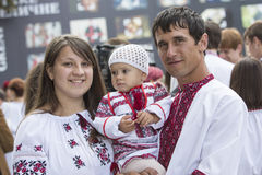 Kiev, Ukraine - August 24, 2013 Celebration of Independence day, beautiful young family Royalty Free Stock Photos