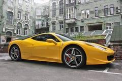 Kiev, Ukraine. August 28, 2017. Ferrari 458 Italia. Yellow supercar on the background of houses stock image