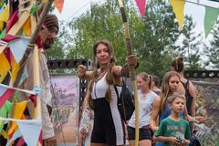 Kiev, Ukraine - August 06, 2017 - Girl aiming from an onion at the atrakration. At the Vadalife Festival stock photo