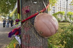 Kiev, Ukraine - August 30, 2016: Helmet on a tree on an improvised monument to those who died during the revolution Royalty Free Stock Photos