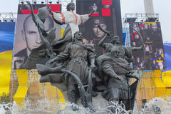 Kiev, Ukraine - August 24, 2016: Monument of the city's founding. And installation with the image of the participants of the antiterrorist operation on Stock Photo