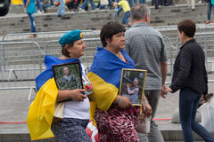 Kiev, Ukraine - August 24, 2016: Mothers with pictures of those killed in the zone of the antiterrorist operation. Soldiers after the parade on Independence Stock Photos