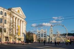 National University Kyiv Mohyla Academy and ferris wheel at Kontraktova square in Kyiv. Kiev, Ukraine - August 10, 2018: National University Kyiv Mohyla Academy stock photography