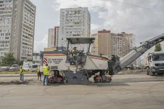 Kiev, Ukraine. August 13 2018 Road works. Road specialized equipment is laying the way. The special car with a hydrohammer removes royalty free stock images