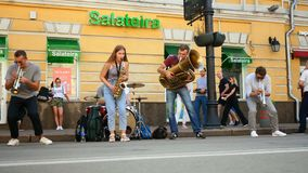 Kiev. Ukraine. August 2019: - Street musical band plays jazz music on wind instruments and makes money for living on. Podol district on Sagaidachnogo street stock footage