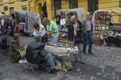 Kiev, Ukraine - August 24, 2016: Tourists and souvenir sellers in the Andreevsky Descent. Historical part of the city Royalty Free Stock Photos