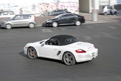 Kiev, Ukraine. August 28, 2017. White Porsche Boxster S in motion royalty free stock image