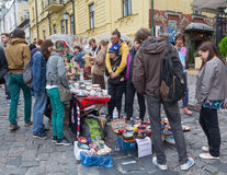 Kiev, Ukraine - August 24, 2016: Youth sells pottery on the street St. Andrew's descent Stock Photo