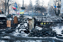 KIEV, UKRAINE: Barricades of tires and scrap erected opposite the police force on the bombed street in government quarter. Barricades of tires and scrap erected royalty free stock photo