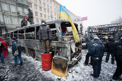 KIEV, UKRAINE: Civil guardians wait for attack of policemen on the barricades of occupying snow street during winter riot Stock Image