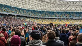 Kiev, Ukraine - 04.14.2019. A crowd of Ukrainians are going to the stadium to support the presidential candidate royalty free stock photography