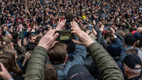 Kiev, Ukraine - 04.14.2019. A crowd of Ukrainians are going to the stadium to support the presidential candidate stock photos