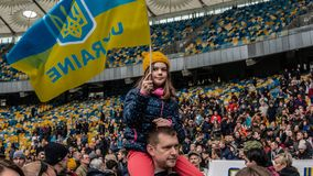 Kiev, Ukraine - 04.14.2019. A crowd of Ukrainians are going to the stadium to support the presidential candidate stock image