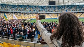 Kiev, Ukraine - 04.14.2019. A crowd of Ukrainians are going to the stadium to support the presidential candidate royalty free stock photos