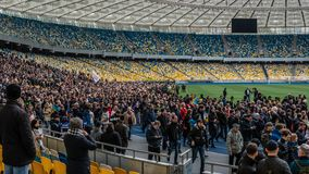 Kiev, Ukraine - 04.14.2019. A crowd of Ukrainians are going to the stadium to support the presidential candidate stock images