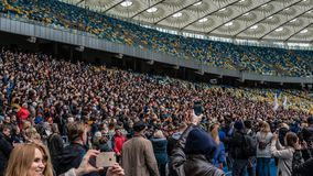 Kiev, Ukraine - 04.14.2019. A crowd of Ukrainians are going to the stadium to support the presidential candidate stock photo