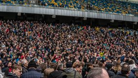 Kiev, Ukraine - 04.14.2019. A crowd of Ukrainians are going to the stadium to support the presidential candidate royalty free stock image