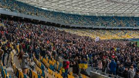 Kiev, Ukraine - 04.14.2019. A crowd of Ukrainians are going to the stadium to support the presidential candidate stock photography