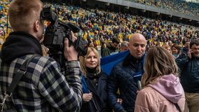 Kiev, Ukraine - 04.14.2019. A crowd of Ukrainians are going to the stadium to support the presidential candidate royalty free stock images
