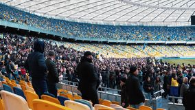 Kiev, Ukraine - 04.14.2019. A crowd of Ukrainians are going to the stadium to support the presidential candidate stock footage