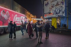 Kiev, Ukraine - December 16, 2017: Advertising campaign of Coca-Cola company on the Independence Square. On the screen is the image of those who died during Stock Images