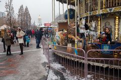 Kiev, Ukraine - December 30, 2018: Festive merry-go-round near Mikhailovskaya Square. On the threshold of a new year celebration stock image