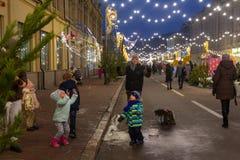 Kiev, Ukraine - December 30, 2018: Man makes big soap bubbles for children on the street. In winter royalty free stock image
