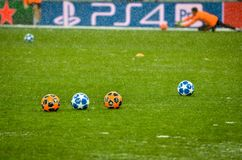 KIEV, UKRAINE - December 12, 2018: Official Champions League Balls in a row lie on the lawn during the UEFA Champions League match royalty free stock photography