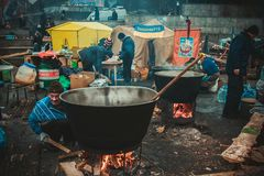 Kiev. Ukraine. December 19, 2013. People cooking in the camp on stock image