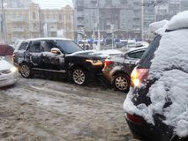 Kiev, Ukraine, December, 2017. Road traffic accident on a snow-covered road in the city in winter during snow. Royalty Free Stock Photography