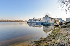 The Silverbridge boat on the Dnieper in Kiev. Kiev/Ukraine - December 8, 2017 - The Silver Breeze boat on the Dnieper in Kiev, Ukraine during a sunny winter royalty free stock photography