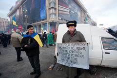 KIEV, UKRAINE: Demonstrators with national symbols and banners call for president to resign during anti-government protest Royalty Free Stock Image