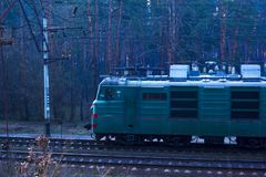 Kiev.Ukraine 03.16.2019  driving along the forestrailway freight train with wagons royalty free stock photography