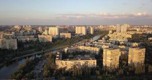 KIEV, UKRAINE - Drone flight over Dnieper river, Patona bridge. And Rusanovka district stock video footage